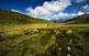 El Plan de Beret és una gran esplanada a 1.850 metres, valorada des d'antic per la riquesa de pastures. En primer terme, les restes d'una estructura del neolític.