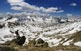 Des de la cresta de Pessons es veu com la vall andorrana del Madriu s'obre camí entre les muntanyes. Al fons es distingeix, encara glaçat, l'estany de l'Illa. És una de les moltes postals que es poden veure recorrent el Camí de l'Òssa.