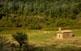 El cràter de Santa Margarida és una pastura, coronada per una església romànica que li dóna nom.