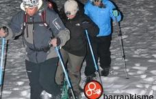 Excursió nocturna amb raquetes de neu a Rialp