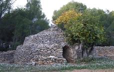 Una de les cabanes de pedra seca de la Ruta de la Capona